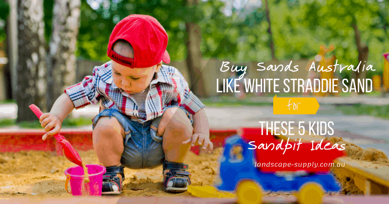 toddler playing in sandpit